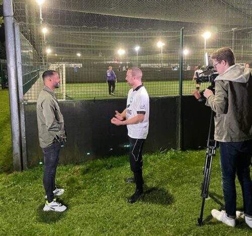 Photo of Gareth Shoulder filming Ashley Cole interviewing a football player